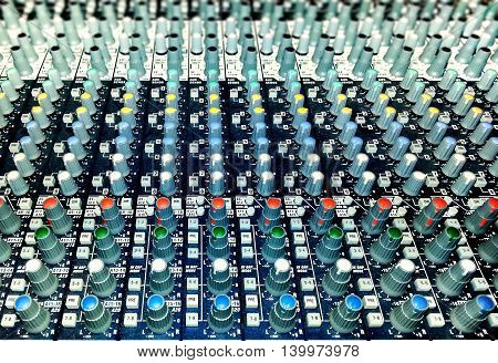 Professional audio mixer with knobs and sliders
