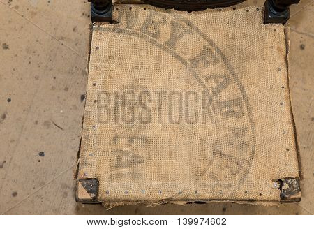 Old Hessian Fabric With The Farmers Cereals Stamped Upholstery Background
