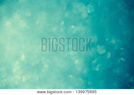bokeh on turquoise background, light, abstract, texture.