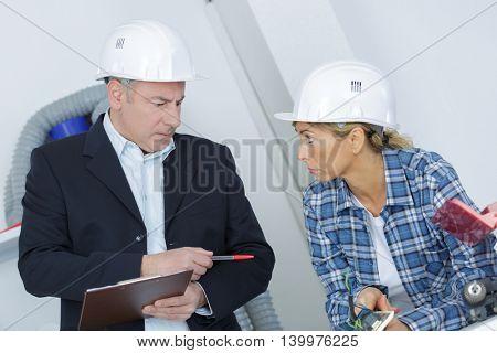 handywoman and her foreman