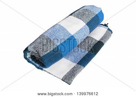Blue tartan wool plaid folded on white background