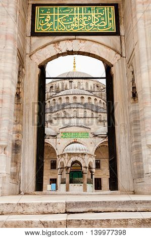 View of Blue Mosque in Istanbul through the entrance gate. Sultanahmet Camii. Travel Turkey. The Muslim religion.