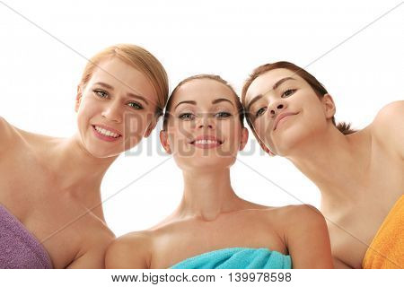 Three beautiful women isolated on white