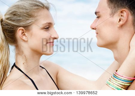 Romantic young couple standing on the beach