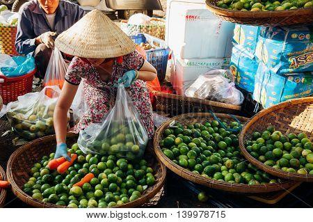 Woman Sells Vegs At The Morning Market, Nha Trang, Vietnam.
