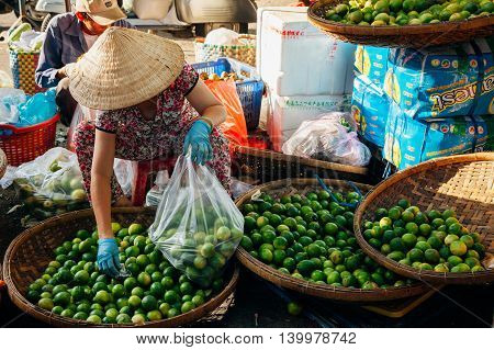 Woman Sells Vegs At The Morning Market, Nha Trang, Vietnam.
