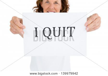 Portrait of smiling woman holding paper with message against white background