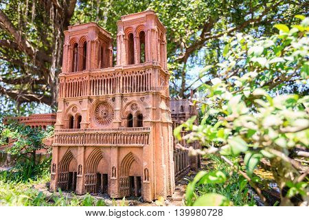 Hoi An, Vietnam - Jun 20, 2015: Model of Temple of Literature made from earthenware and displayed at Thanh Ha earthenware village, Hoi An ancient town. Hoi An is a World Cultural Heritage (UNESCO).