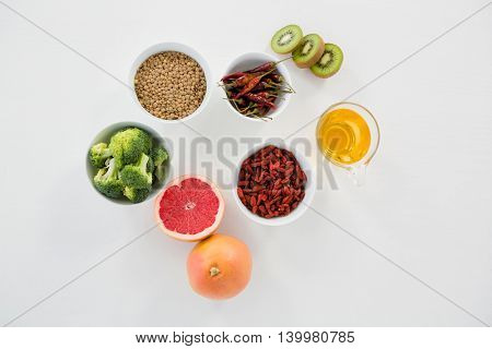 Directly above shot of food and drink over gray background