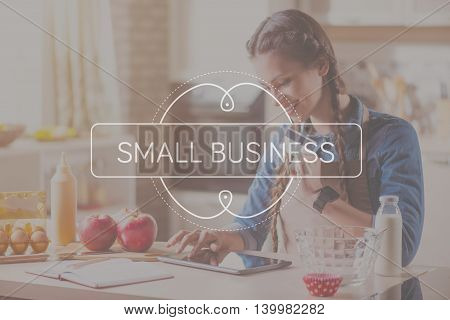 Financial operations. Inspirational typographic quote about small business with cheerful young woman using a credit card and digital tablet for buying online in a background