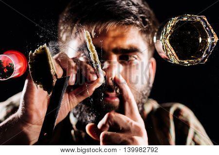 Drug abuse man taking drugs snorting cocaine portrait.