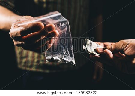 Drug addict buying narcotics and paying pose