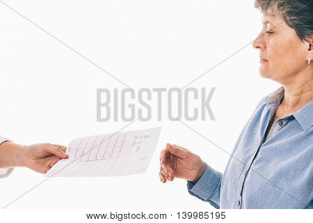 Senior woman is receiving an electrocardiogram from her doctor - isolated on white background