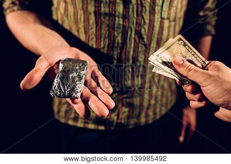 Unknown people buying and paying for drugs.