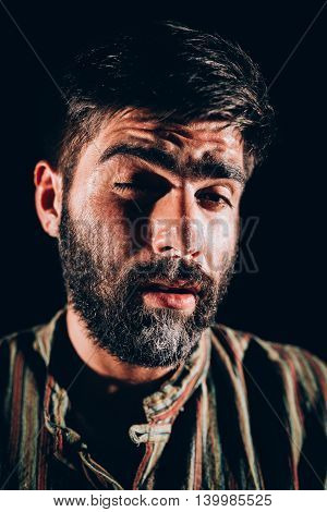 Bearded men being high after sniffing cocaine