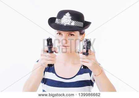 Profile of a young dangerous woman holding guns in her hands - isolated on white