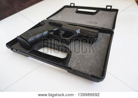 Real semi-automatic gun in box isolated on white background