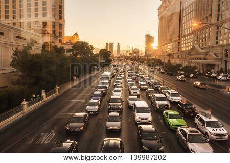 LAS VEGAS NV USA - JULY 13 2013: High traffic on Flamingo Road near one of Caesar's Palace's entrances.