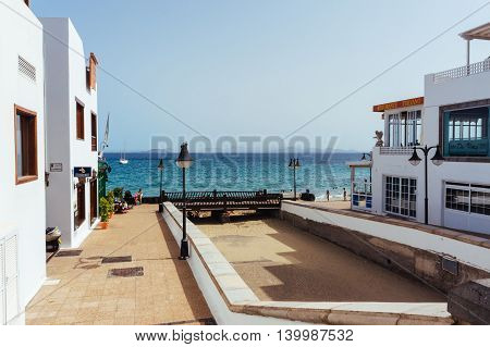 Canary Island Spain - June 29 2014: Tourist having lunch at a typical restaurants with ocean view in Lanzarote.