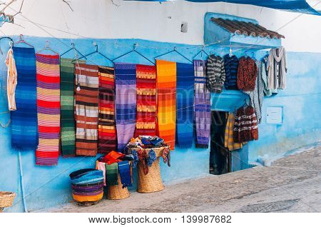 Moroccan traditional textile products in different colors at a shop in Chefchaouen Morocco
