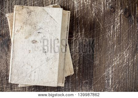 Vintage old books on wooden deck tabletop. Top view.