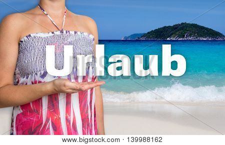 Urlaub (in german Holiday) concept is presented by woman on the beach.