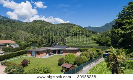 aerial view of a modern brick house with garden