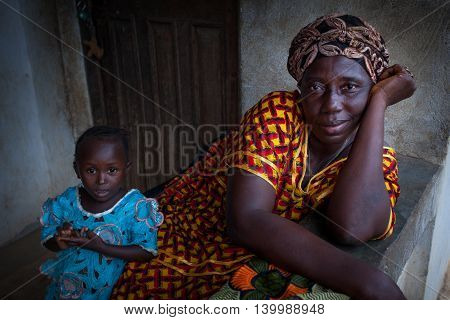 Yongoro Sierra Leone - June 02 2013: West Africa the village of Yongoro in front of Freetown woman with her baby