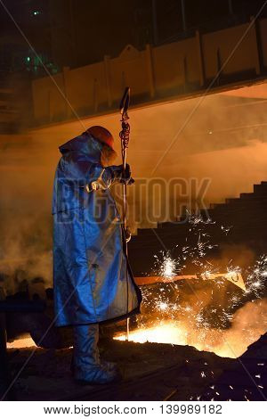 Steel worker in steel plant, close up