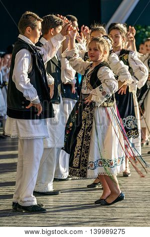 ROMANIA TIMISOARA - JULY 7 2016: Child Romanian dancers in traditional costume perform folk dance during