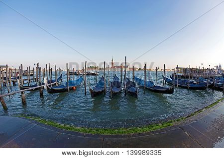 VENICE ITALY - AUGUST 5 2015: Fish eye view of Grand Canal with gondolas and San Giorgio Maggiore church.