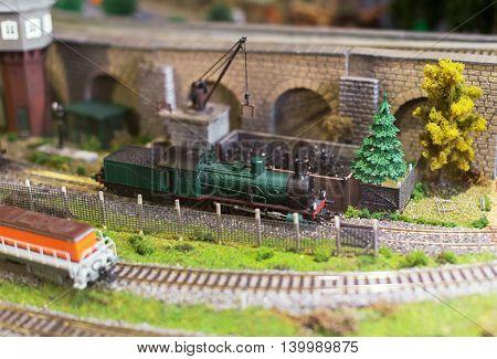 City In Miniature. Model Of Train On Railstation.