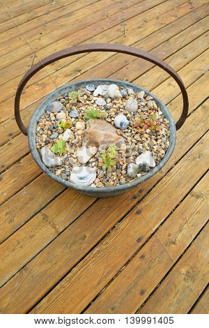 Beautifuly decorated garden pot on a wooden patio
