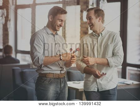 Need rest. Inspirational communication with image of two positive and cheerful men holding darts and smiling in a background