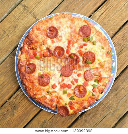 Freshly baked pizza on a wooden table