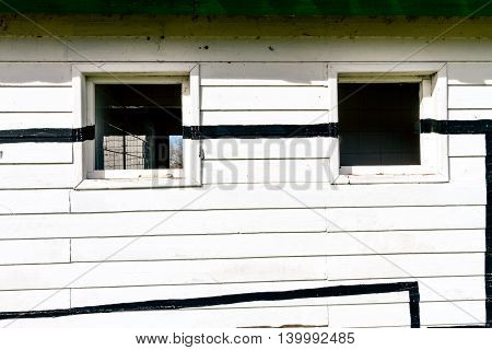 White rustic wood wall with windows and lines