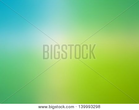Abstract gradient blue green colored blurred background