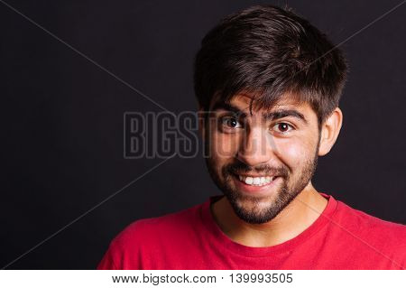 Bearded man with a happy expression - isolated on black.