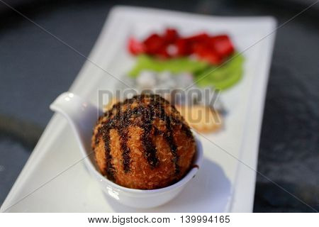The Fried ice cream with many fruit.