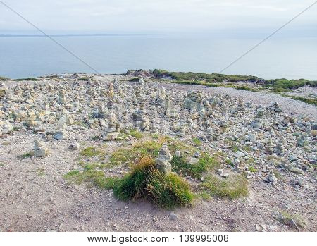 coastal scenery with lots of small stacked stone piles at the Crozon peninsula in Brittany France