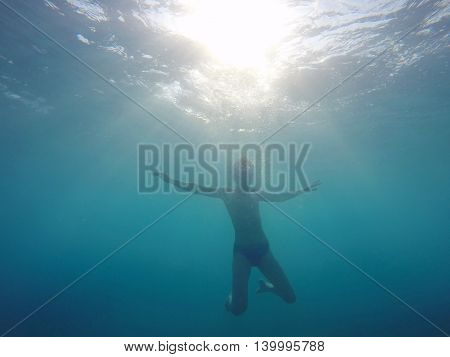 boy dives into the sea