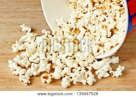 Popcorn snack on wooden background selective focus