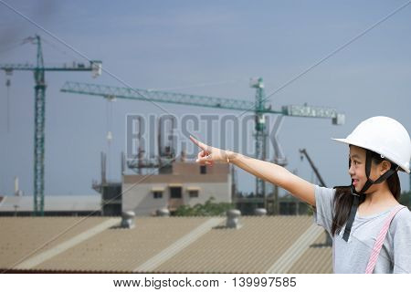 girl pointing finger : Girl wear hat engineers are pointing.