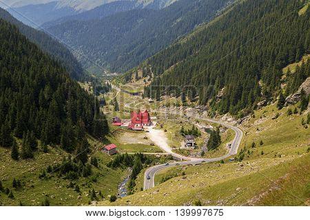 Summer landscape of Transfagarasan highway and Capra chalet in Fagaras Mountains, Romania