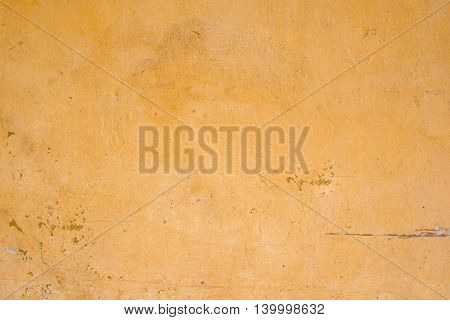 Background Of Old Yellow Grunge Wall