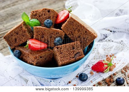 American chocolate cake brownie with summer fruits and berries selective focus