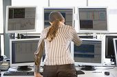foto of computer-screen  - Stock Trader Looking At Multiple Monitors - JPG