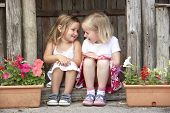 foto of montessori school  - Two Young Girls Playing in Wooden House - JPG