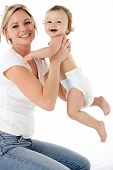 stock photo of happy baby boy  - Studio Portrait Of Mother With Young Baby Boy - JPG