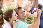 stock photo of happy family  - Family Playing Together In Garden At Home - JPG